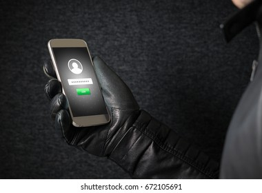 Identity theft and cyber security concept. Mobile hacker and criminal login to persons online social media account or personal information and data with smartphone. Thief with black leather gloves.