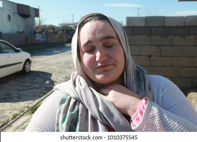 IDIL, SIRNAK - MARCH 31: A sad woman after the conflict between the Kurdish protesters and the Turkish police in Idil, Sirnak. The Photo Taken March 31, 2016.
