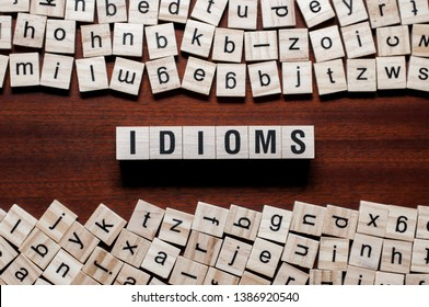 Idioms word concept on cubes