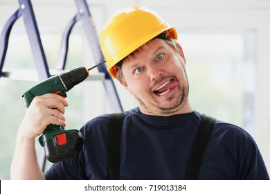 Idiot worker using electric drill portrait.