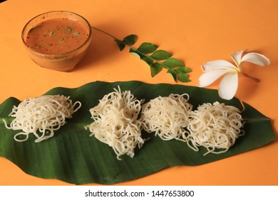 Idiyappam/ String Hoppers -Traditional Kerala Steamed Breakfast served with Chickpea (Kadala) curry top vew