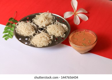 Idiyappam/ String Hoppers -Traditional Kerala Steamed Breakfast on white and red background