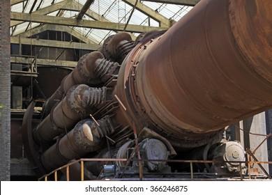 idle cement plant rotary kiln machinery, closeup of photo