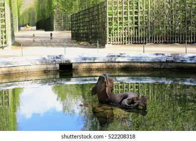 the idle fountain in the form of fish in a secluded alley of the Park in Versailles