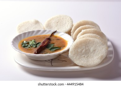 Idli with Sambar and coconut chutney, Indian Dish : south Indian favourite food rava idli or semolina idly or rava idly, served with sambar and green coconut chutney.