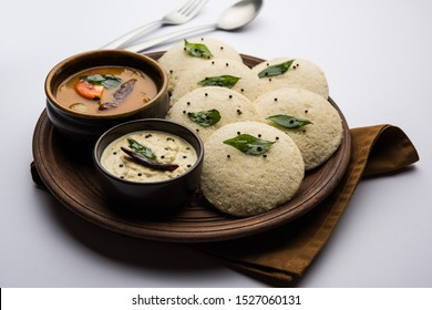 Idli Sambhar or Idly Sambar is a popular south Indian food, served with coconut chutney. selective focus