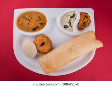 Idli, Vada and Masala dosa is a South Indian meal served with sambhar and coconut chutney.  Selective focus
