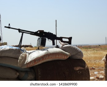 idlib , north / syria - 7 june 2019 : syrian armed rebel fighters positions during ongoing battles against syrian regime forces backed by russian army.