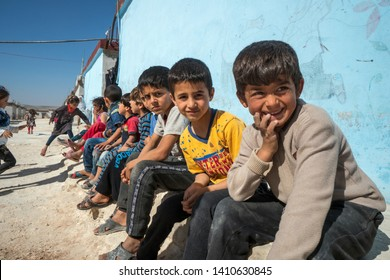 IDLIB, SYRIA – MAY 18: Despairing children in orphan camp of faith on May 18, 2019 in Idlib, Syria. In the civil war that began in Syria in 2011, 12 million people were displaced.