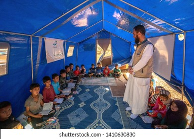 IDLIB, SYRIA – MAY 18: Refugee children studying in tents on May 18, 2019 in Idlib, Syria. In the civil war that began in Syria in 2011, 12 million people were displaced.