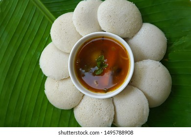 Idlis /Steamed rice cakes - South Indian breakfast served in banana leaf, selective focus