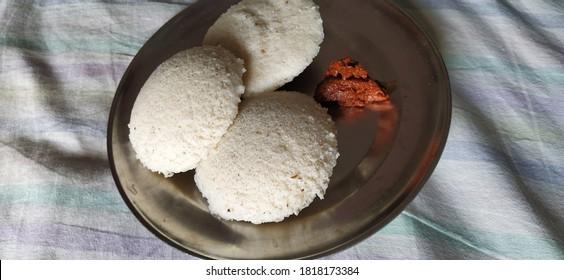 idly plate with mango chutny - Shutterstock ID 1818173384