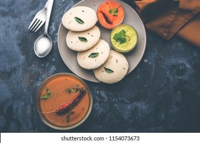 Idly sambar or Idli with Sambhar and green, red chutney. Popular South indian breakfast
