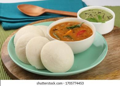 Idly sambar or Idli with Sambhar and green chutney. Popular South indian breakfast