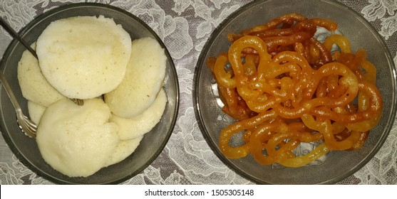 Idly , south Indian popular dish with Jalebi or jilbi or imarti , north indian delicious sweet. Top view.
