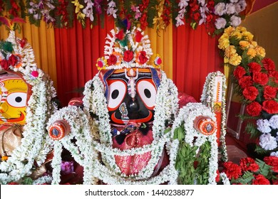 Idol of Hindu God Jagannath. Lord Jagannath is being worshipped with garlands for Rath jatra festival - at Howrah, West Bengal, India.