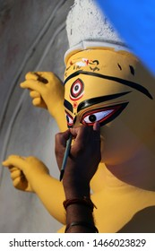 Idol of Hindu Goddess Durga during preparations in Kolkata. Clay idol of Goddess Durga, under preparation for Bengal's Durga Puja festival at Kumartuli Kolkata. Durga Puja is biggest festival in India