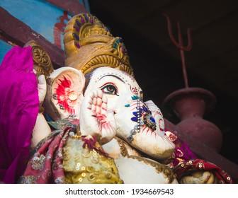 An idol of lord Ganesha. Low angle view, festival, hindu religion. Ganesh chaturthi.