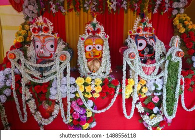 Idols of God Jagannath, Balaram and Goddess Suvadra. Lord Jagannath is being worshipped with garlands for Rath jatra festival - at Howrah, West Bengal, India.