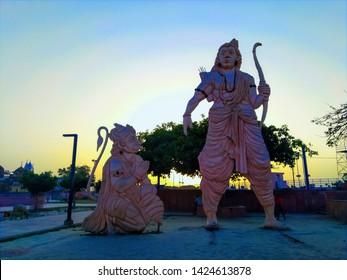 Idols of Ram and Hanuman Lord standing in Ayodhya city. Large sculpture of Ram, Hanuman near Laxman Nagar. Large statue of Lord against sunset sunrise. Ayodhya, Uttar Pradesh/India - April 28, 2019