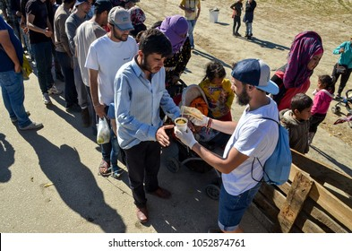 Idomeni, Greece, April 15, 2016 -  A refugees waits in line to get food. The camp for refugees and migrants at the Greek-Macedonian border near Idomeni. The European refugee and migration crisis