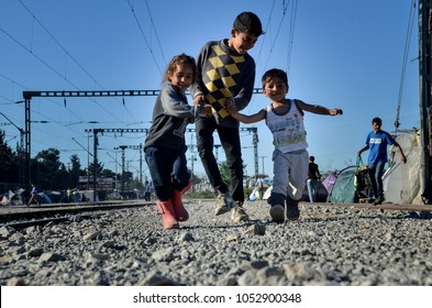 Idomeni, Greece, April 15, 2016 -  Childrens are playing in refugee camp. Transit camp for refugees and migrants at the Greek-Macedonian border. The European refugee and migration crisis