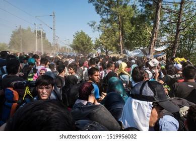Idomeni, Greece - August 29, 2015. A crowd of refugees wait to cross the Greek Macedonian border.