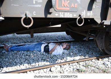Idomeni, Greece - August 29, 2015. A migrant sleeps under a train wagon at the train station of Idomeni as he waits to cross the Greek Macedonian border.