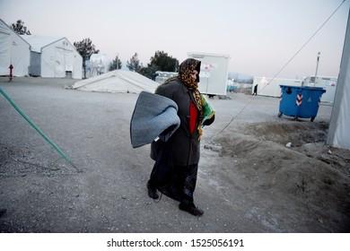 Idomeni, Greece - January 15, 2016. A Syrian refugee woman walks inside the makeshift refugee camp of Idomeni at the Greek Macedonian border.