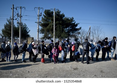 Idomeni, Greece - January 15, 2016. Refugees wait in a queue in order to cross the Greek Macedonian border.