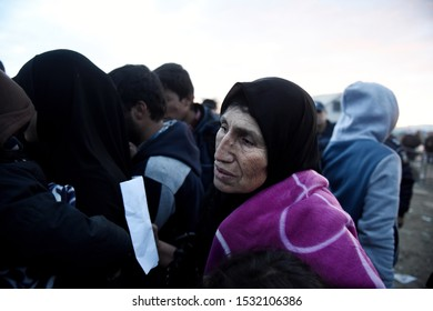 Idomeni, Greece - January 15, 2016. An elderly refugee woman waits to cross the Greek-Macedonian border.