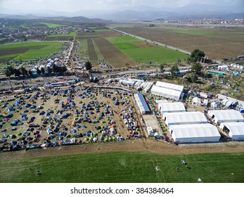 Idomeni, Greece - March 1, 2016: Thousands of immigrants are in a wait at the border between Greece and FYROM waiting to cross the borders to FYR of Macedonia. Aerial shot with drone