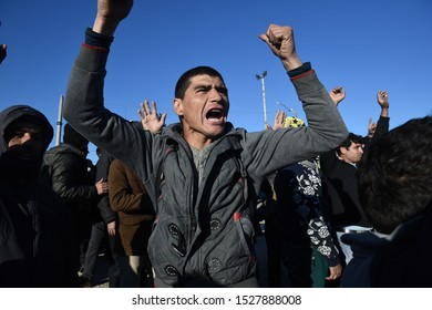 Idomeni, Greece - March 3, 2016. A refugee shouts slogans during a protest inside the makeshift refugee camp of Idomeni at the Greek Macedonian border.