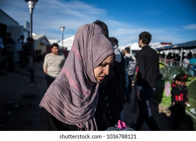 Idomeni, Greece - March 8, 2016. A Syrian refugee woman walks inside the makeshift refugee camp of Idomeni, at the Greek Macedonian border.