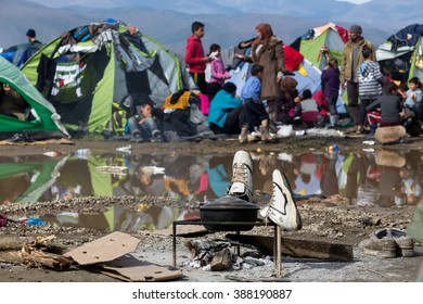 Idomeni, Greece - March 8, 2016: Thousands of immigrants wait at the border between Greece and FYROM waiting to cross the borders to FYR of Macedonia.