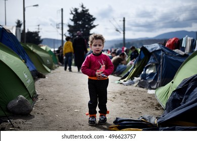 Idomeni, Greece - March 8, 2016. A Syrian boy stands outside his tent, as around 10000 refugees and migrants remain stranded at the Greek Macedonian border, at the makeshift refugee camp of Idomeni.