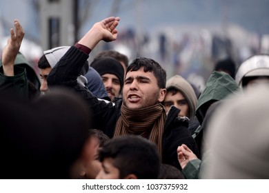 Idomeni, Greece - March 9, 2016. A refugee man chants slogans, as refugees and migrants demonstrate demanding for the European Union borders to open, in the refugee camp of Idomeni.