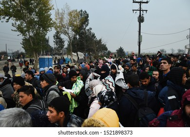 Idomeni, Greece - November 12, 2015. A crowd of refugees wait to cross the Greek Macedonian border.