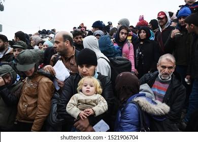 Idomeni, Greece - November 12, 2015. Syrian refugees wait to cross the Greek Macedonian border.
