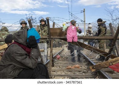 Idomeni, Greece,  November 29, 2015: Hundreds of immigrants are in a wait at the border between Greece and FYROM waiting for the right time to continue their journey from unguarded passages