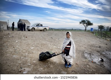 Idomeni, Greece - October 23, 2015. A Syrian refugee kid poses for a photo as refugees wait to cross the Greek Macedonian border.