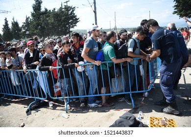 Idomeni, Greece - September 18, 2015. A crowd of refugees wait to cross the Greek Macedonian border.