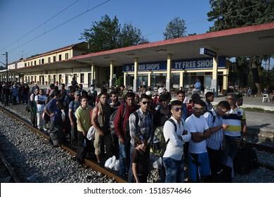 Idomeni, Greece - September 4, 2015. Refugees wait at the train station of Idomeni to pass the Greek Macedonian border.