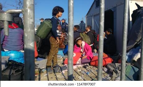 Idomeni, Greece/Kilkis - 05/12/2018: Idomeni Refugee Camp, Child waiting near the border line Greece - Macedonia for his turn to pass.