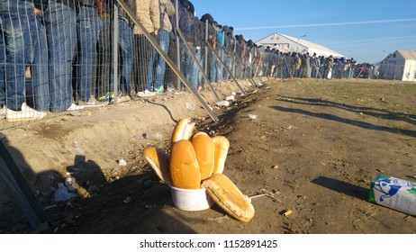 Idomeni, Greece/Kilkis - 07/12/2015: Refugees waiting at the line to get some food at Idomeni Camp