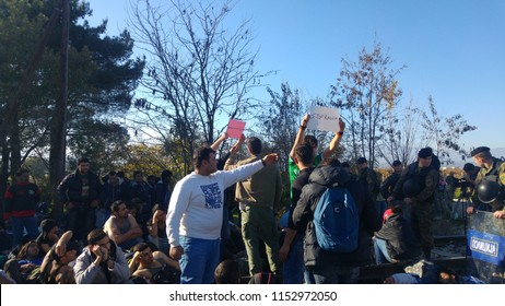 Idomeni, Thessaloniki / Greece 19/11/2015 : Migrants protest against racism in frond of Macedonians Police at the border line in Idomeni camp hopes police open the borders.