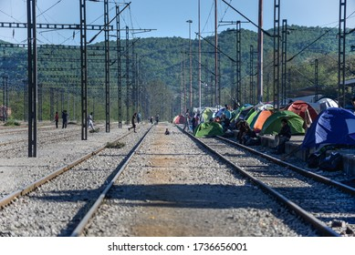 Idomeni/Greece-April 15, 2016: Improvised tent city on railway tracks. Transit refugee/migrant camp at the Greek-North Macedonian border. People on the move stuck on their way to Western Europe.