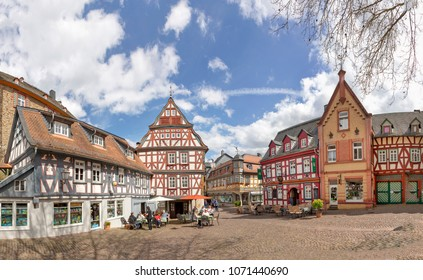 IDSTEIN, GERMANY - APR 15, 2018: people enjoy sitting outside at old historic market place in Idstein with beautiful half timbered medieval houses.