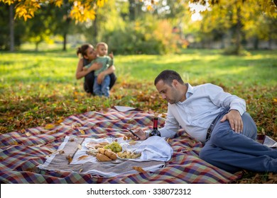 Idyll scene of young family having picknick in the park