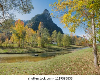 idyllic ammer river and view to kofel mountain, beautiful oberammergau landscape in autumn
